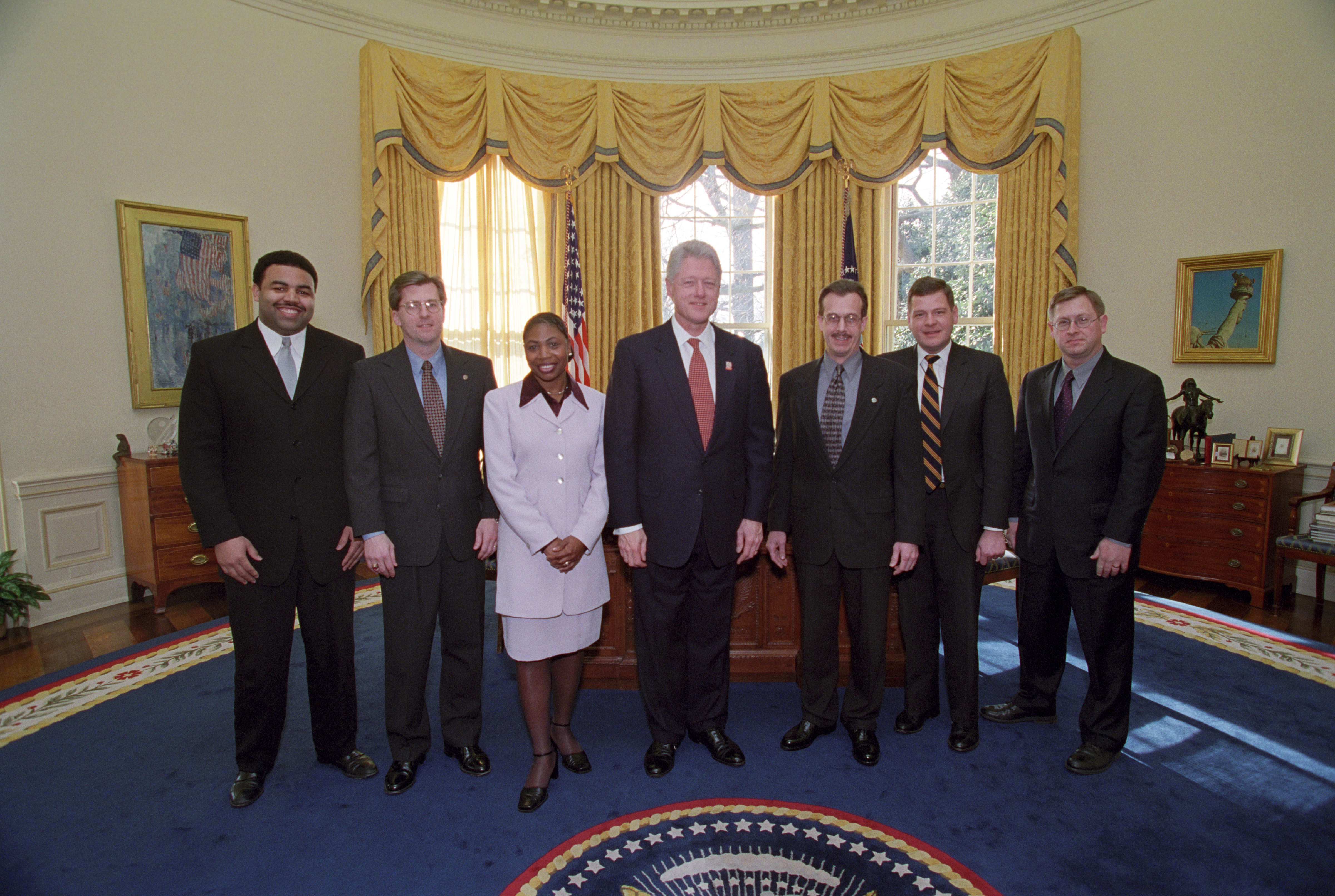 President Clinton joins the staff of the Clerk's Office for a group photo in the Oval Office