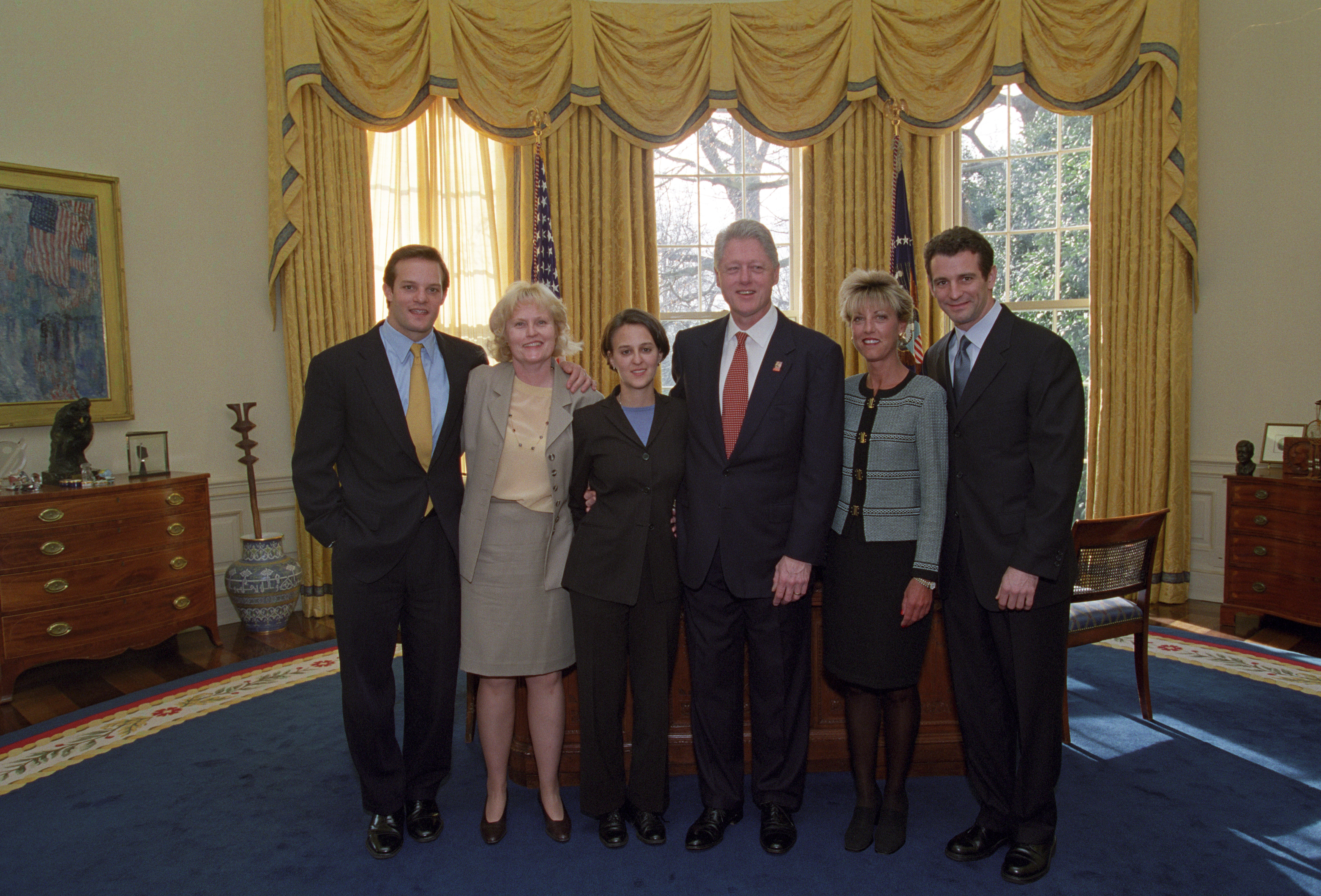 President Clinton joins the staff of the Staff Secretary's Office for a group photo in the Oval Office