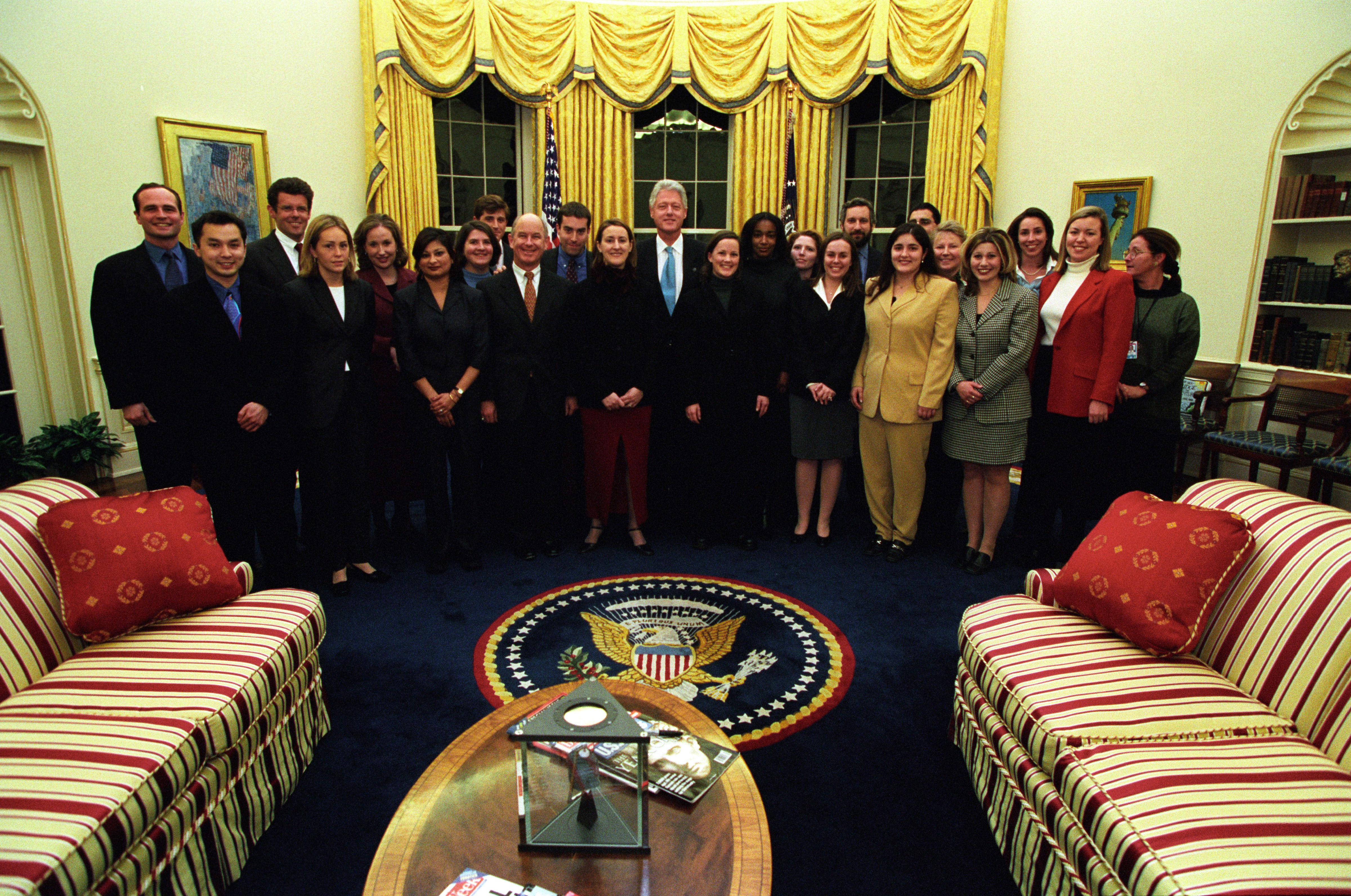 President Clinton joins the staff of the Press Secretary's Office for a group photo in the Oval Office