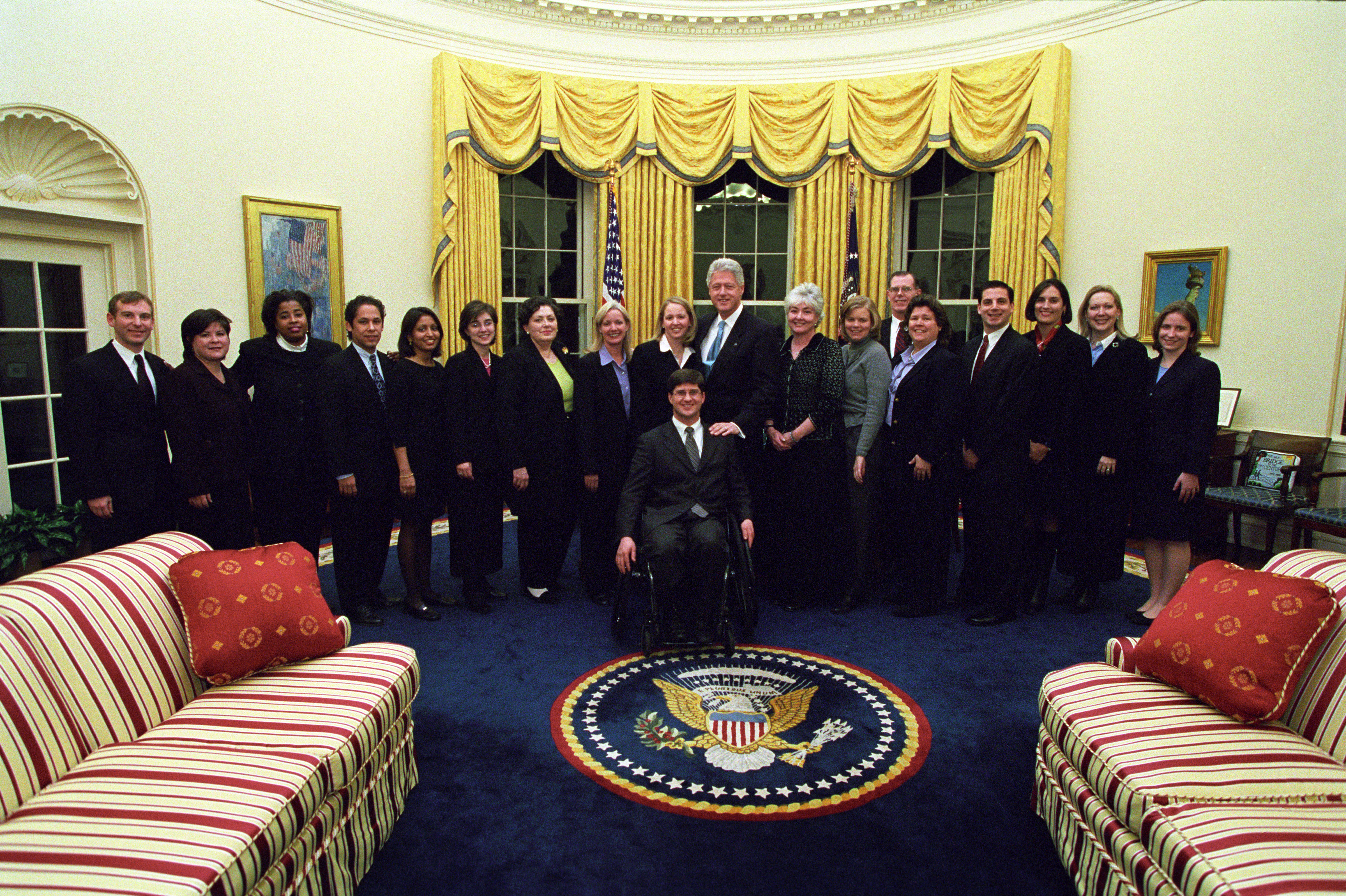 President Clinton joins the staff of the Public Liaison Office for a group photo in the Oval Office