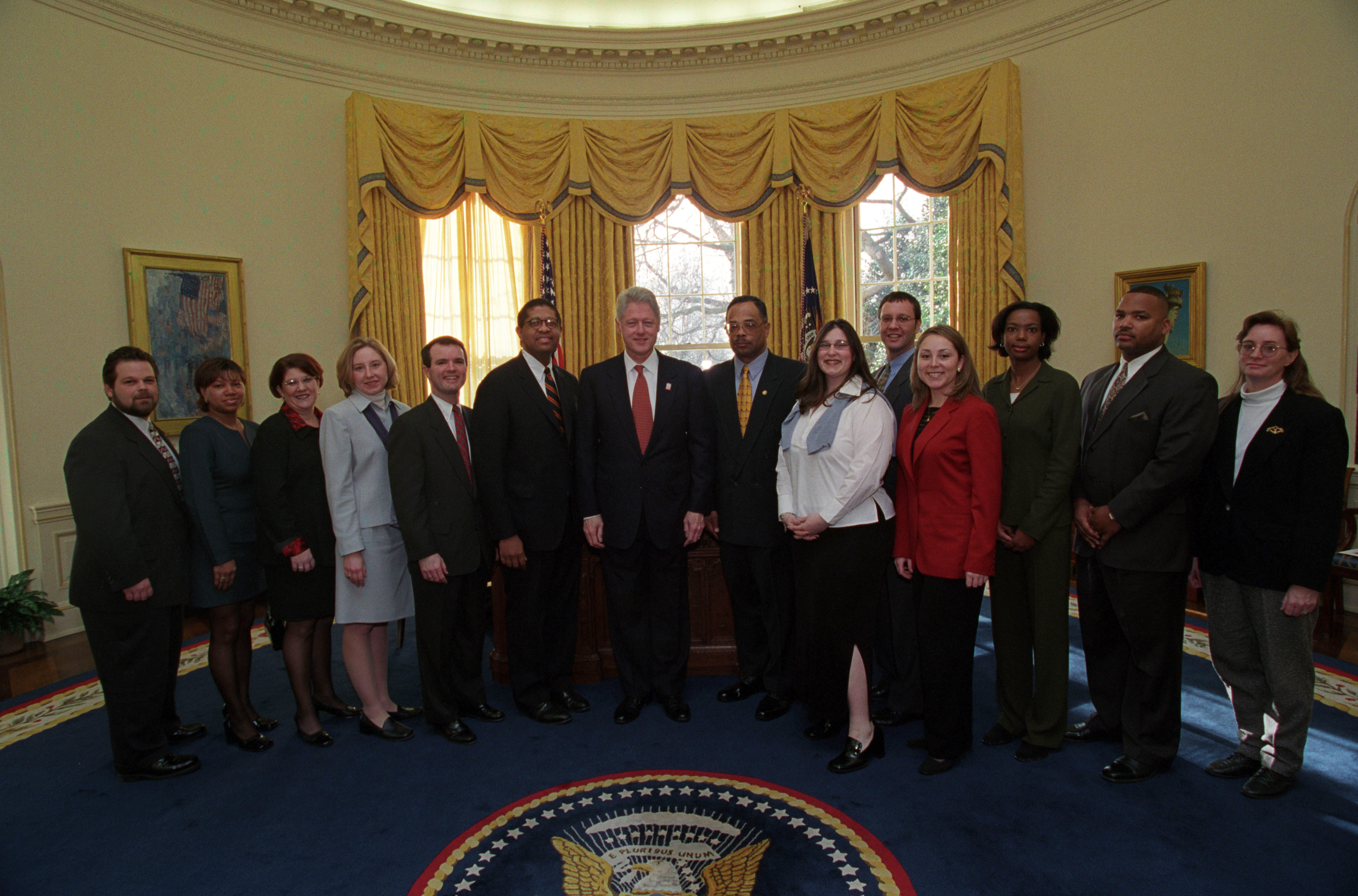 President Clinton joins the staff of the Management and Administration Office for a group photo in the Oval Office.