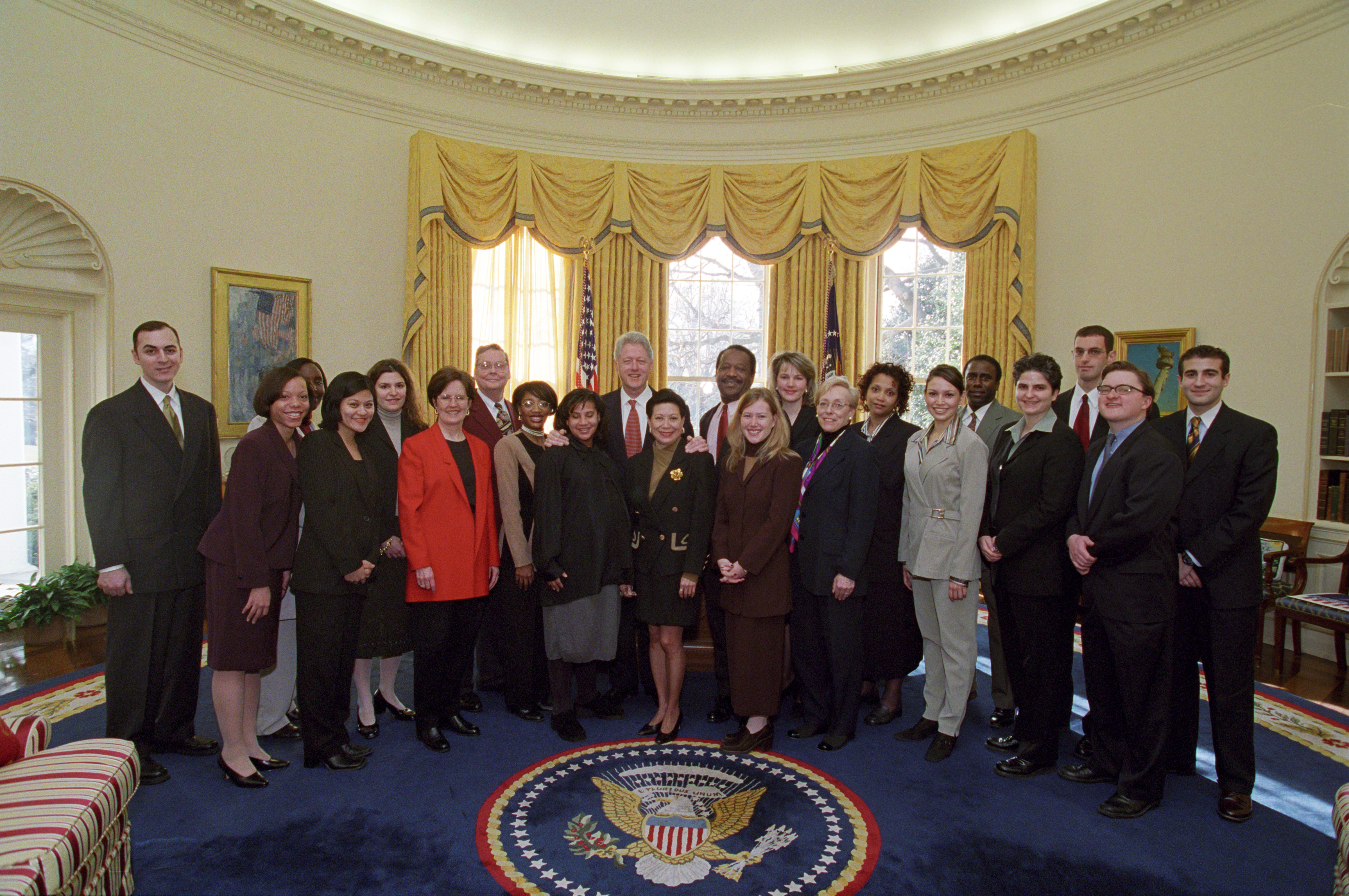 President Clinton joins the staff of the Presidential Personnel Office for a group photo in the Oval Office