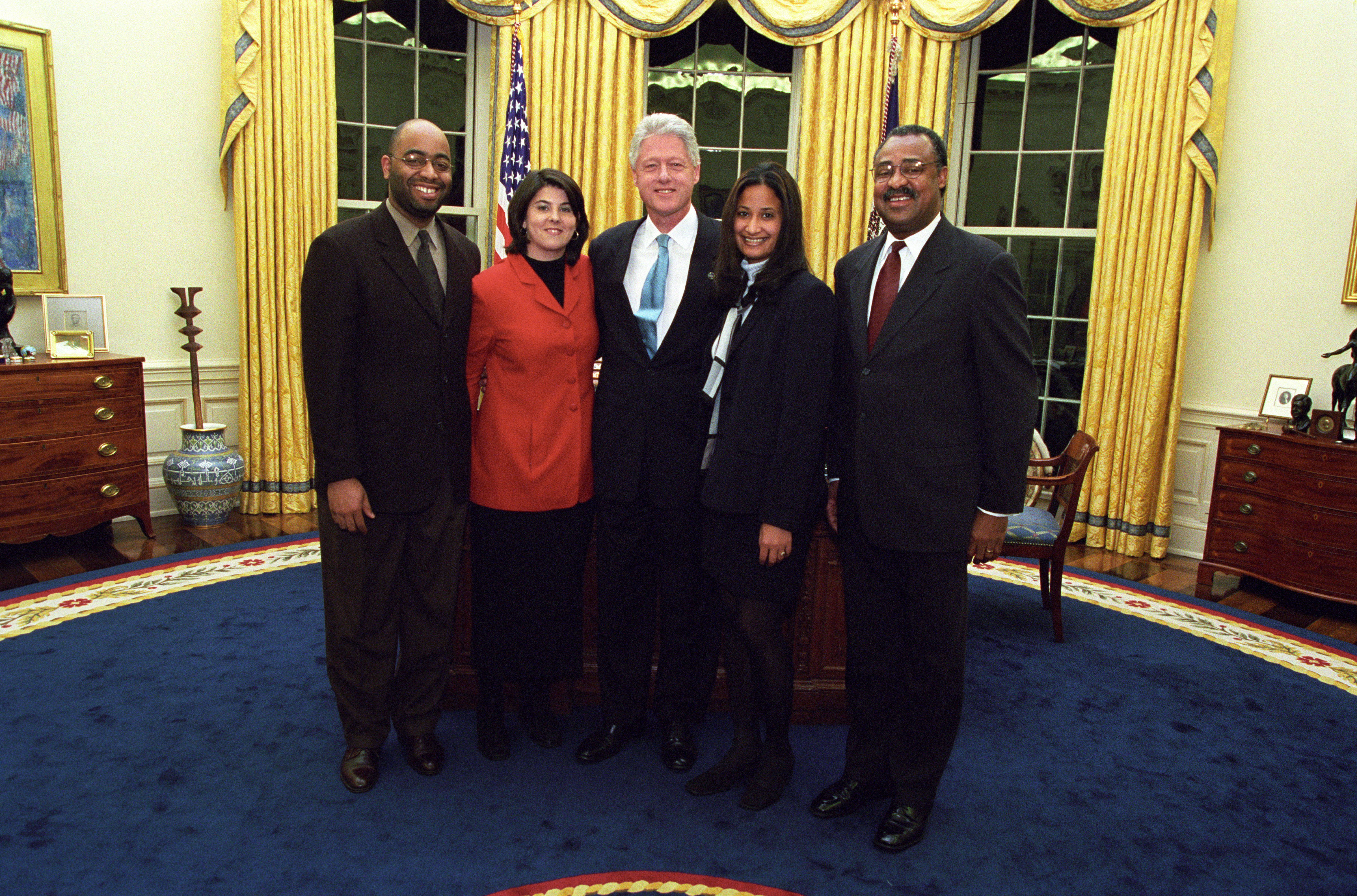 President Clinton joins the staff of the One America Office for a group photo in the Oval Office