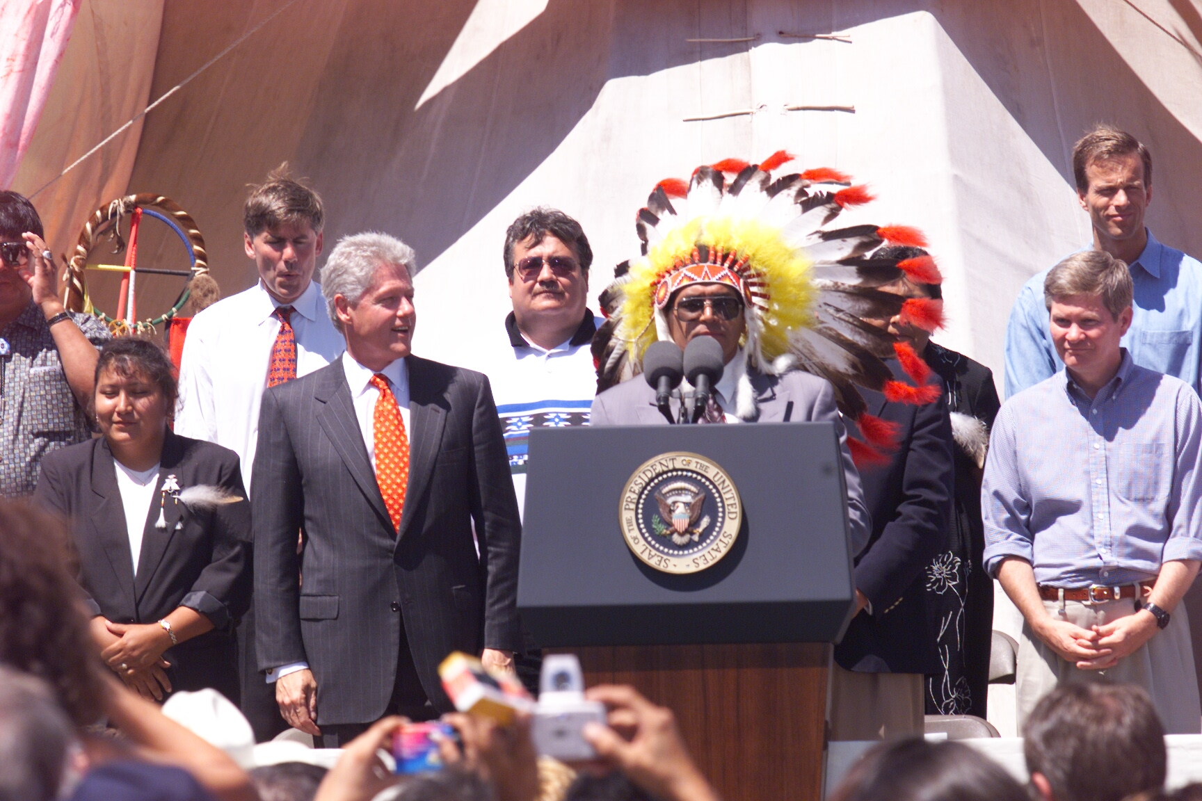 President of the Oglala Lakota Nation welcomes President Clinton, dignitaries and guests to Pine Ridge Reservation in South Dakota. Following remarks from tribal leaders and government officials, President Clinton delivered remarks to the Pine Ridge community as part of his New Markets tour. Platform guests included Senator Tom Daschle, Senator Tim Johnson, Representative John Thune, and Secretary of Housing and Urban Development, Andrew Cuomo.