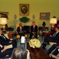 President Clinton meeting with President Jean-Bertrand Aristide of Haiti in the Oval Office.