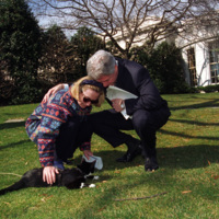 The Clintons with Socks the Cat