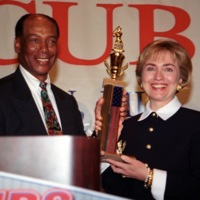 Ernie Banks presenting the Ernie Banks Positivism Trophy to Hillary Clinton
