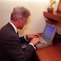 President William Jefferson Clinton Writing an Email to Senator John Glenn